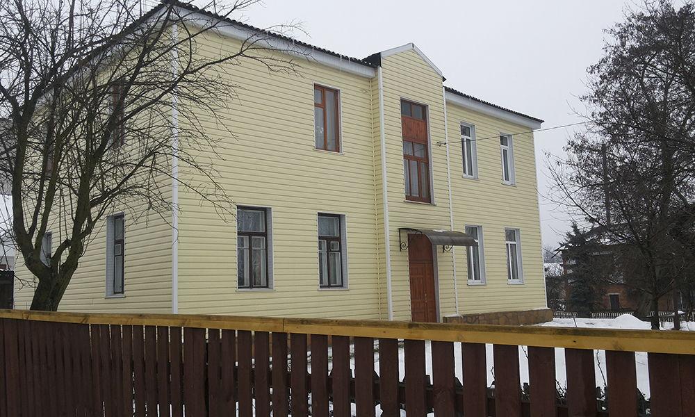 Фото здания с сайдингом желтым от Альта-Профиль