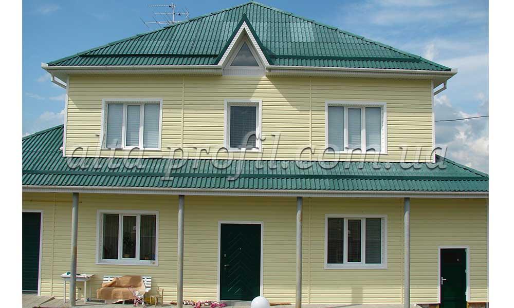 фасад с желтым виниловым сайдингом Kanada от Альта-Профиль