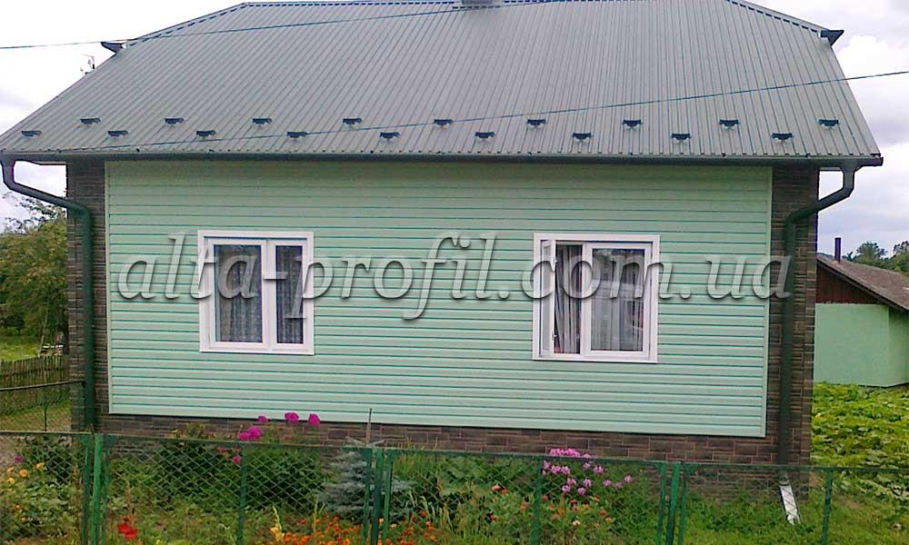 Дом с сайдингом зеленым от Альта-Профиль