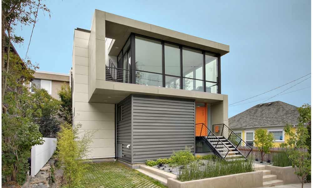 двухэтажный дом с серым сайдингом в стиле модерн